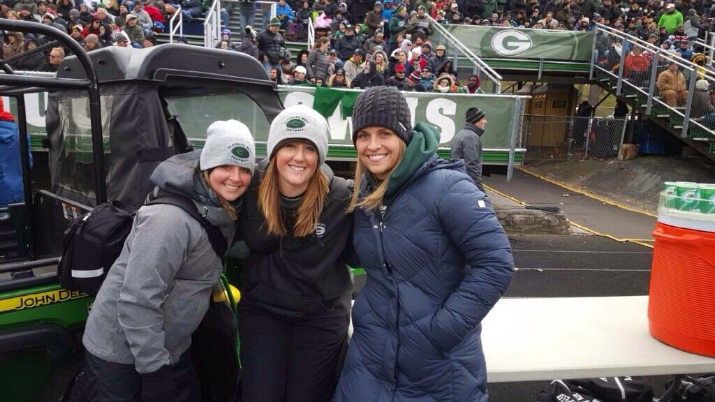 (From left to right) Jen Bednarek, Heather Jenkins,  and Alli Jones pose for a picture at a Glenbard West football game.
