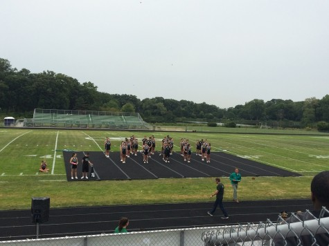 The cheerleaders begin performing for the crowd