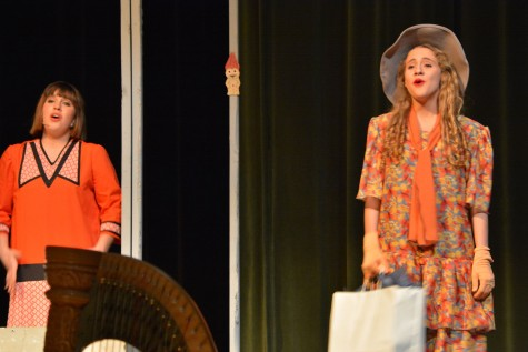 "Anna (right) sings on stage in the 2014 production ""Thoroughly Modern Millie""."