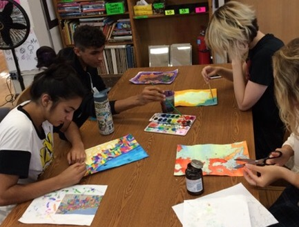 5th Period Painting 1 students are hard at work creating their colorful pieces of original art.