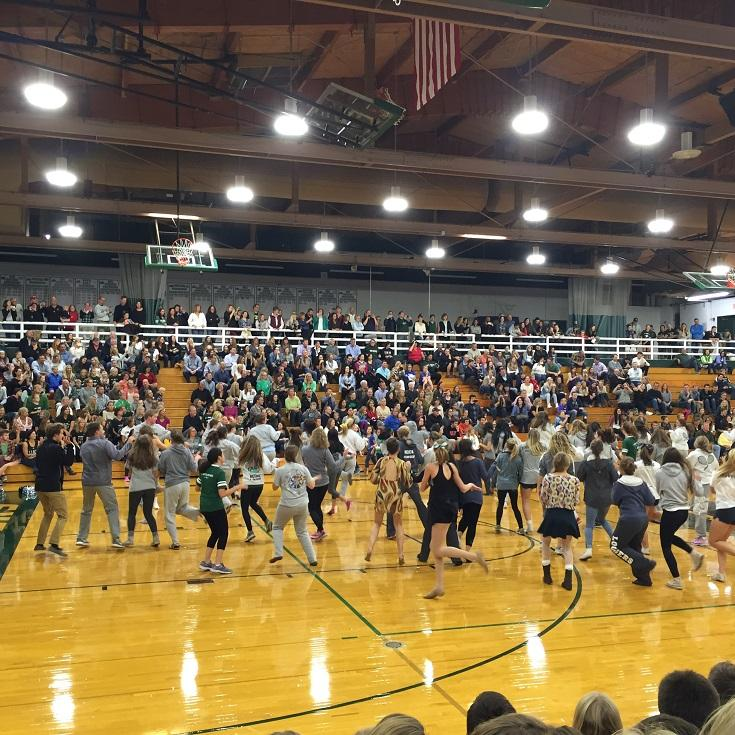 Seniors dance at the Homecoming Pep Rally and Bonfire