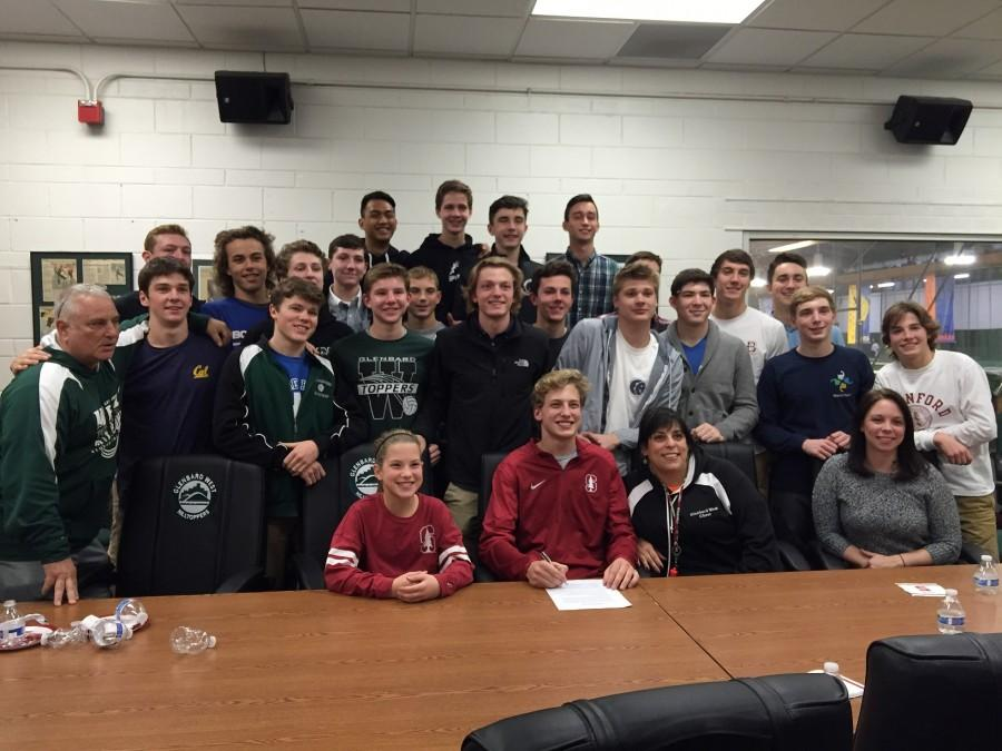 Pauls friends, coaches, and family join him at his official signing day.