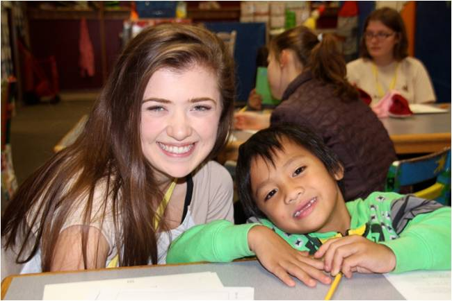 Child Dah Eh poses with teen volunteer at the Glen Ellyn Children's Resource Center.