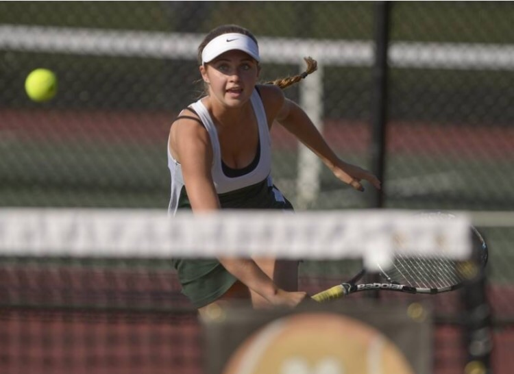 Caroline+Maltby+fighting+for+the+win+in+her+match+against+Wheaton+Warrenville+South+during+the+previous+season.