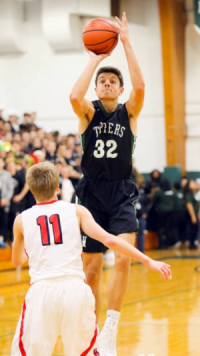 Justin Pierce, number 32 and college commit, goes up for the shot at a home game this season.