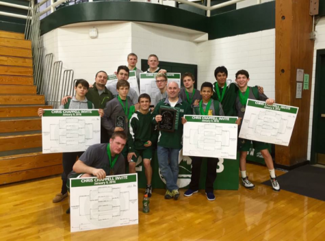 The team holds up their successful results at the Chris Chappell Invite.