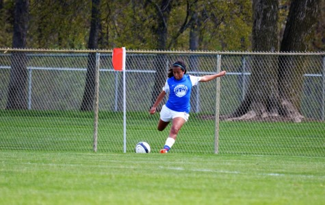 Alex Salgado, senior, sports her Sockers FC jersey and is positioned to swing at her signature corner kick.