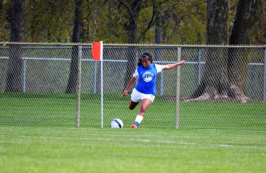 Alex+Salgado%2C+senior%2C+sports+her+Sockers+FC+jersey+and+is+positioned+to+swing+at+her+signature+corner+kick.+