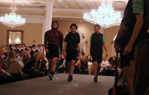 Michael (center) and his longtime friends Alex (left) and Jackson (right) strut down stage at this year's Senior Showcase.