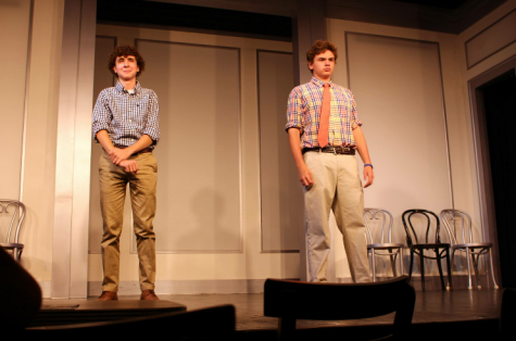 Michael (left) on stage performing at Second City in Chicago.