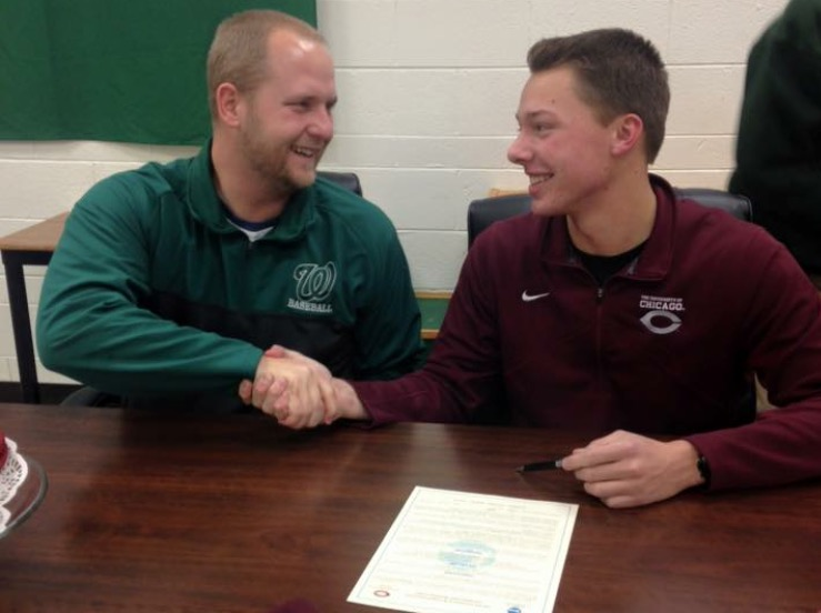 Arno and Coach Schultz shake hands on Curtis' UChicago signing day.