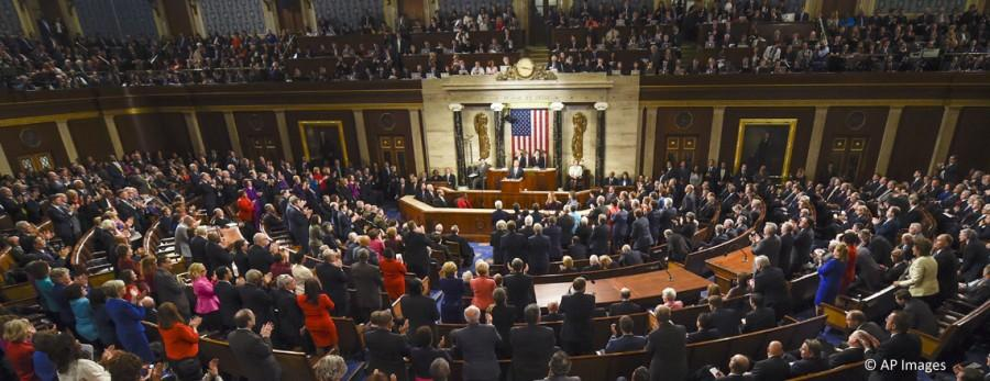 President Barack Obama is applauded as he gives his State of the Union address before a joint session of Congress on Capitol Hill in Washington, Tuesday, Jan. 12, 2016. (AP Photo/Susan Walsh)