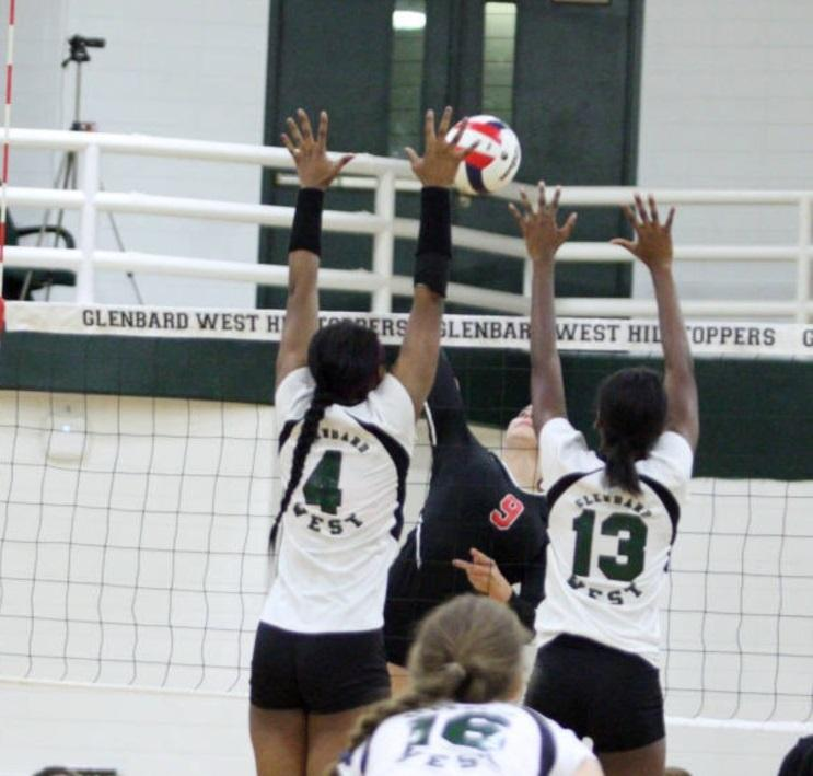 Quiana Ware (4) goes up for a block alongside her fellow West teammate.