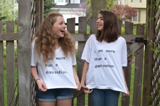Emily Davidson and Roxy Geballe with their protest shirts.