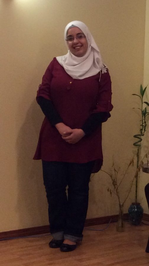 Hawraa Faisal happily poses in her current home after having been living in the U.S. for eight years.