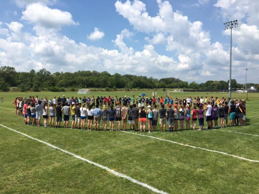 The+Glenbard+West+Marching+Band+gets+together+for+a+group+bonding+activity+on+their+first+day+at+camp.