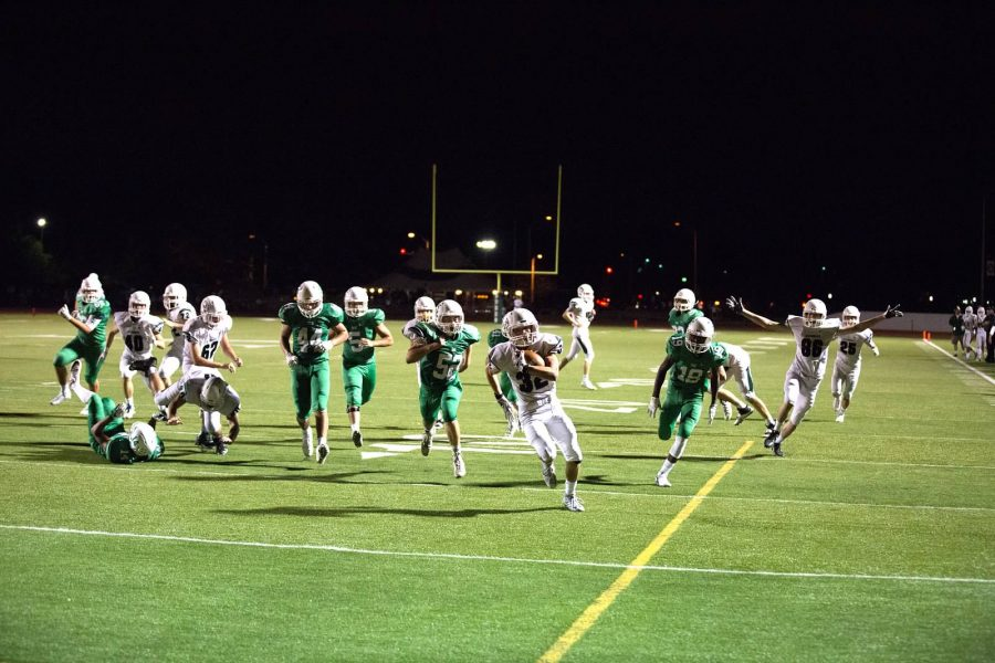 Senior Keith Bowers holds the ball tightly as he makes his way into the end zone.