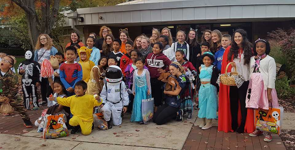 Members of Key Club  helped out the community by trick - or - treating with kids from the Glen Ellyn Children's Resource Center. (GECRC)