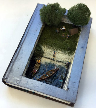 Malcolm Mehr uses a book to create a relaxing scene by a lake.