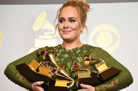 Adele holds her 5 Grammy Awards at the 2017 Grammy Music Awards. (Grammy.com)