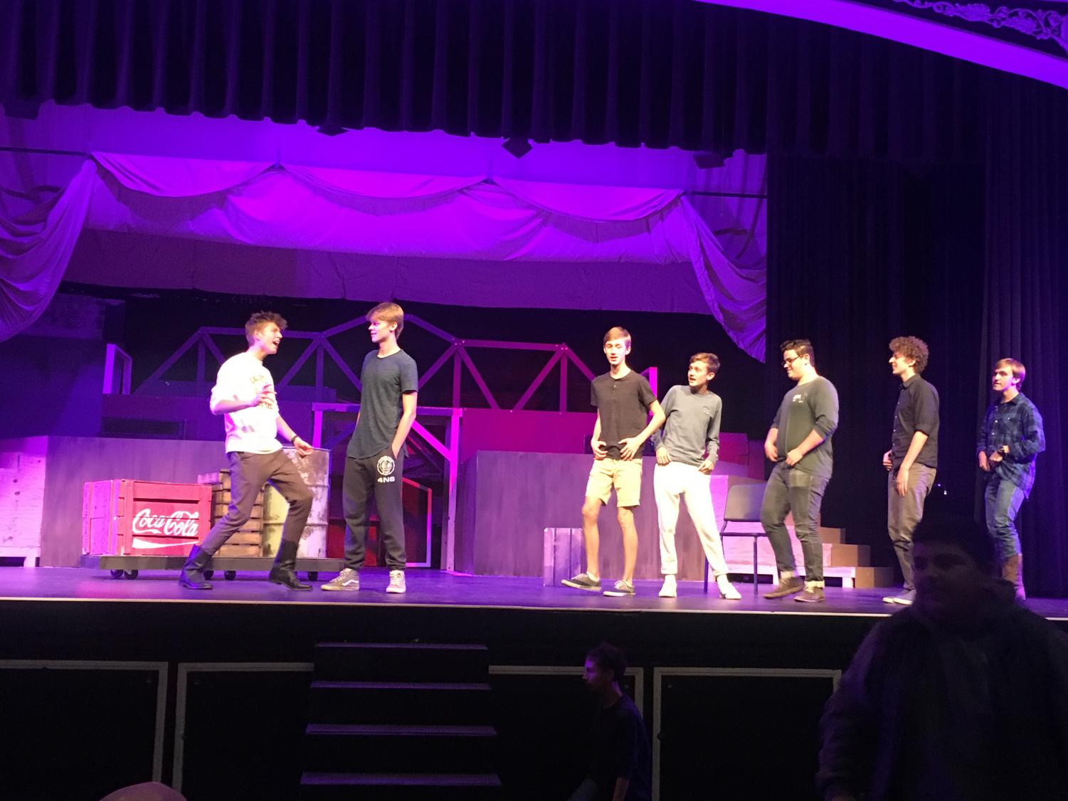 The Footloose assemble practices during Tech Week.