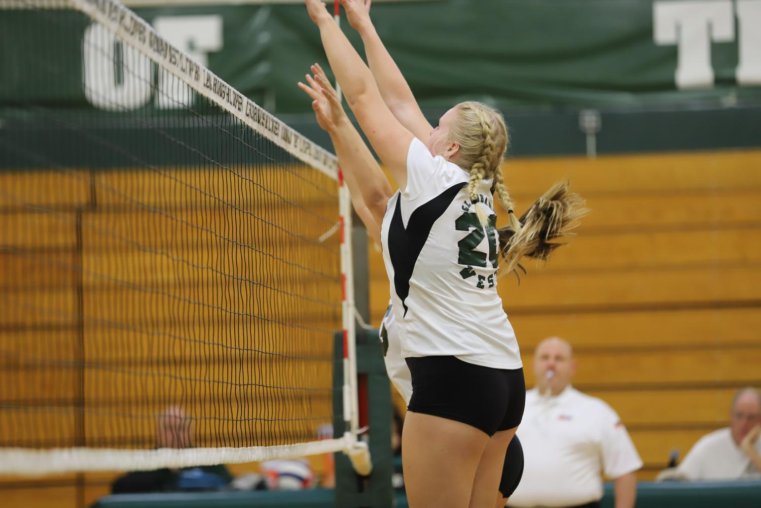 Middle+Hitter+Emory+Kennebeck+%28sophomore%29+jumps+for+a+block.