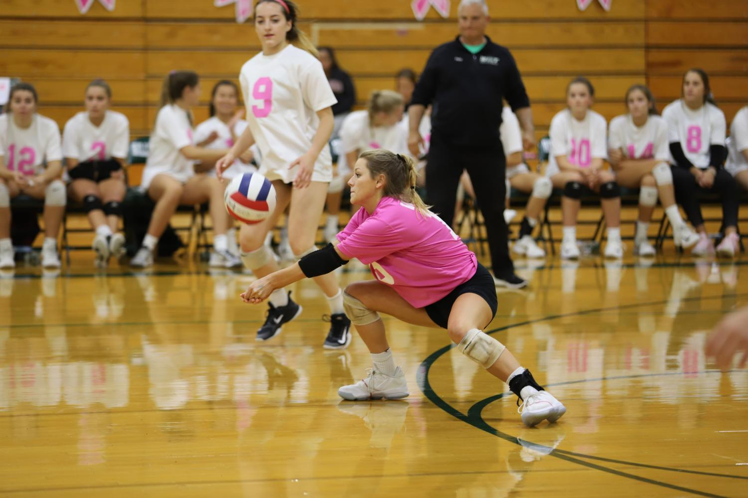 Libero+Katie+Ryan+%28senior%29+digs+the+ball.+Katie+dressed+in+a+pink+jersey+to+promote+the+theme+of+breast+cancer.