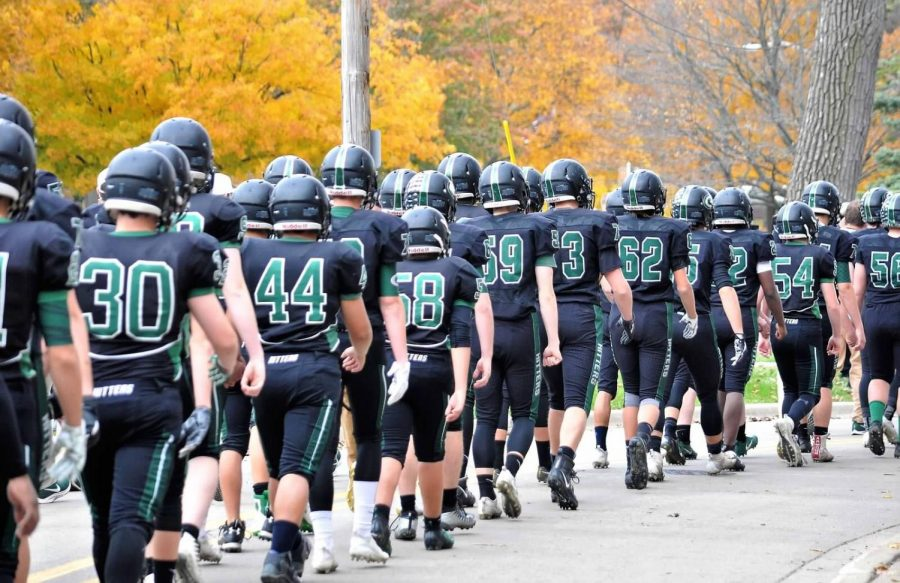 The Hitters walk down the hill before the Lincoln Way East game