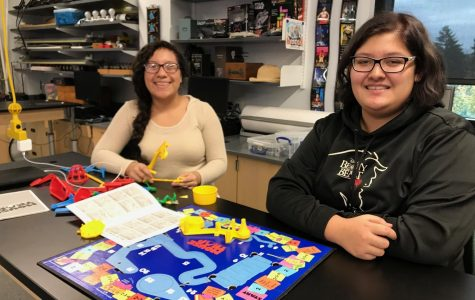 Alexandra Perez and Eowyn Keaton assemble their game board.
