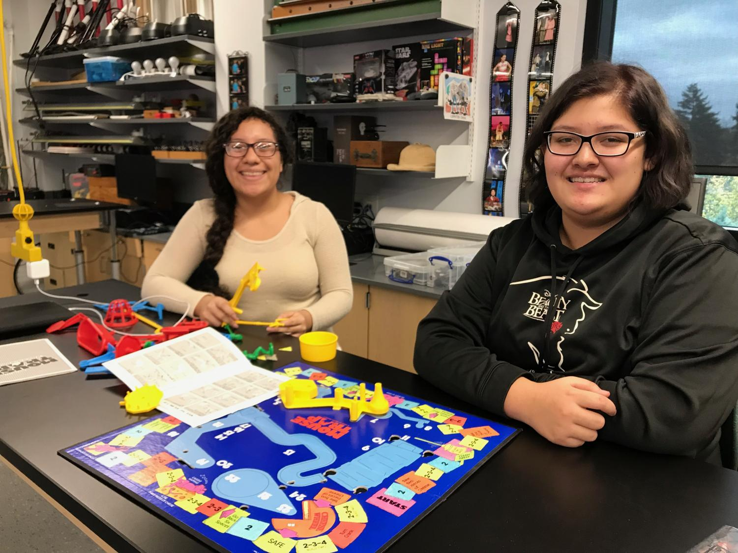 Alexandra Perez and Eowyn Keaton assemble their game board.