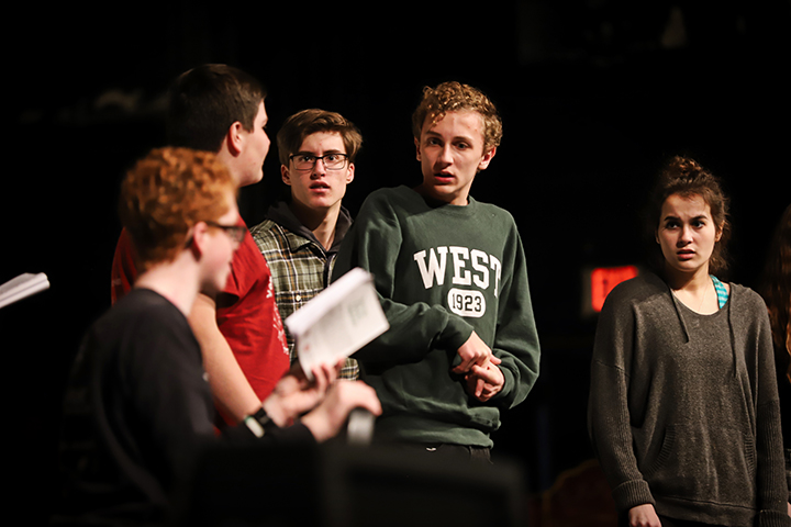 Dionysus and Xanthias are held captive by the Frogs (from left to right; JB Bletsas, Cooper Garland, Josh Reifel.)