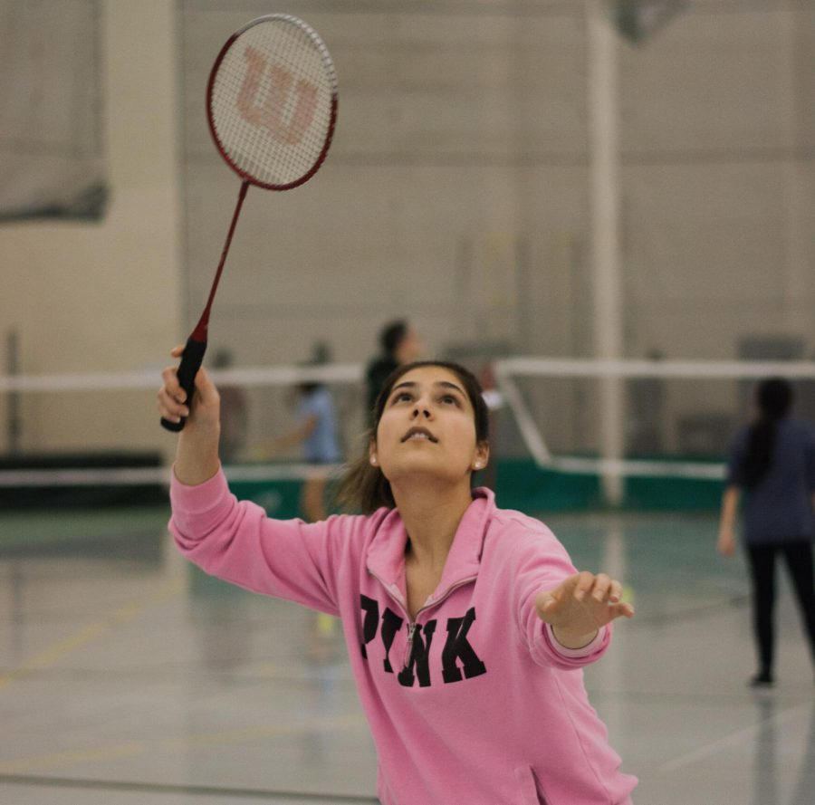 Junior varsity player Laiba Khan receives a serve from a teammate during practice.