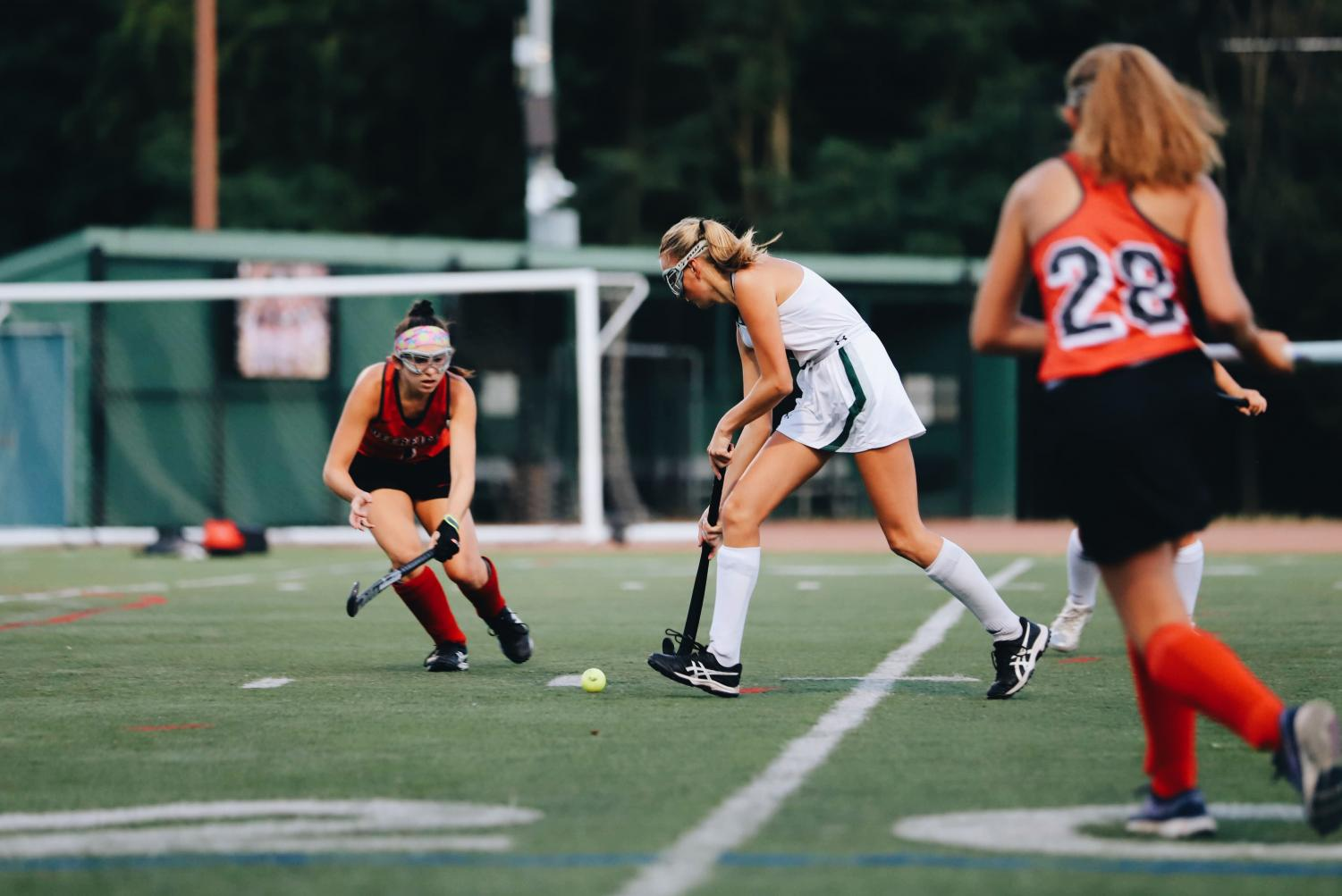Evelyn Erickson (junior) makes a move to advance past a Deerfield defender.