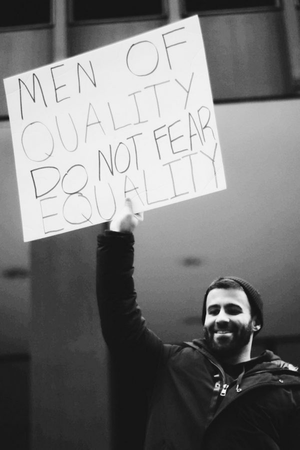 "A favorite composition of mine, ""Men of quality do not fear equality!"" A strong saying coming from many men who attended, the true meaning of feminism can be perceived through the event's representative assembly."