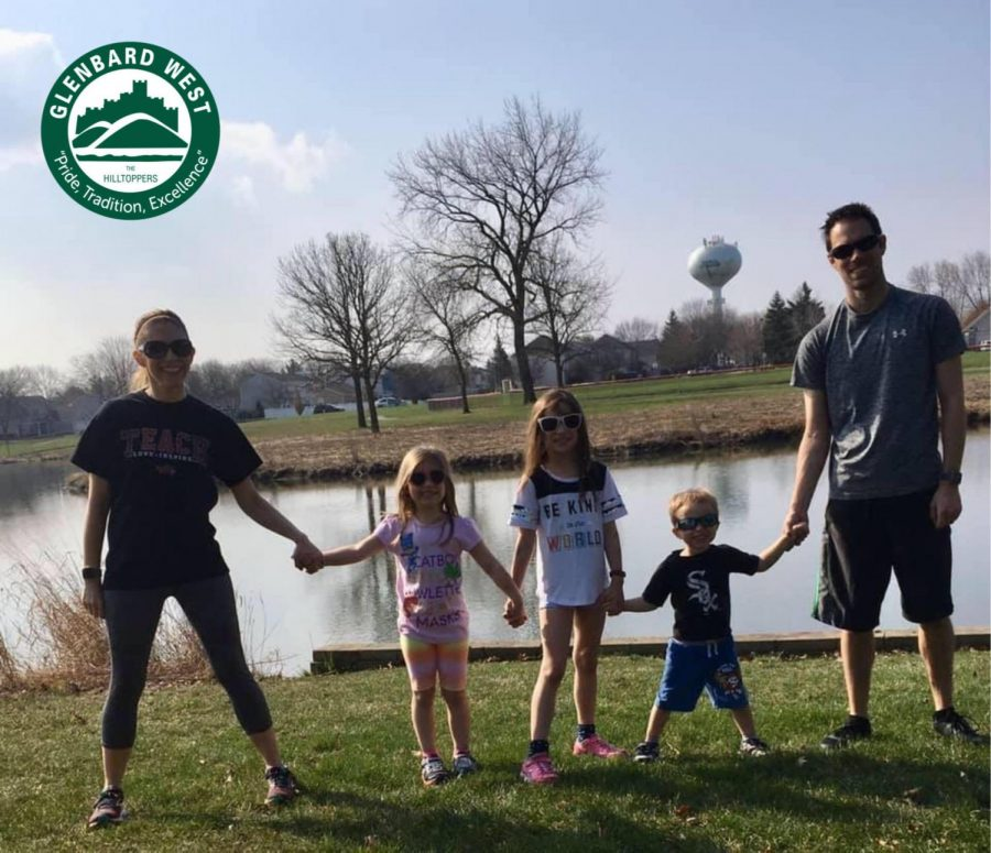 Math teacher Mrs. Schmerer and her family take a walk by the lake near their home.